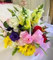 Basket arrangement. Daisy, Snaps, Roses, Lizianthus