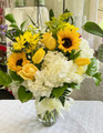 A great way to brighten someones day! This cheerful and bright arrangement consists of white hydrangea, sunflowers, tulips, daisies and other specialty flowers and greenery.     ***All online orders will be AS CLOSE AS POSSIBLE to the picture shown, minor substitutions for a similar flower might be necessary if the flower is not available or out of season. You can rest assured that each order is made with intention and LOTS of LOVE with only the freshest top quality flowers!