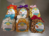 1 Bag of 2 Cups of gourmet flavors or original butter popcorn with a bow.  Please call or email for choice of flavors