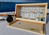 The Saltwater Angler's Pint Presentation Box can be customized with a NOAA chart background and a hand-painted fly on the lid.