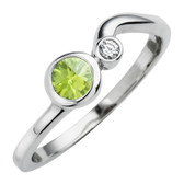 August birthstone, genuine Peridot 4mm round set in 10kt white gold with a .03ct sparkling diamond.