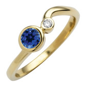 September birthstone, Created Blue Sapphire 4mm round set in 10kt yellow gold with a .03ct sparkling diamond.