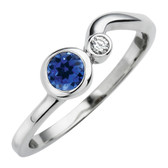 September birthstone, Created Blue Sapphire set in 10kt white gold with a .03ct sparkling diamond.