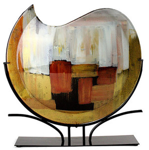 Yellow, red, black and white are featured on this partly round fused glass vase