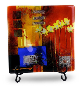 "12"" square, red fused art glass platter, featuring a blue blocking, orange and black details and yellow flowers"