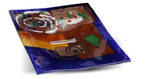 "12"" square fused glass platter featuring blue, yellow, red glass, with abstract designs, appliqued objects and a white spiral"
