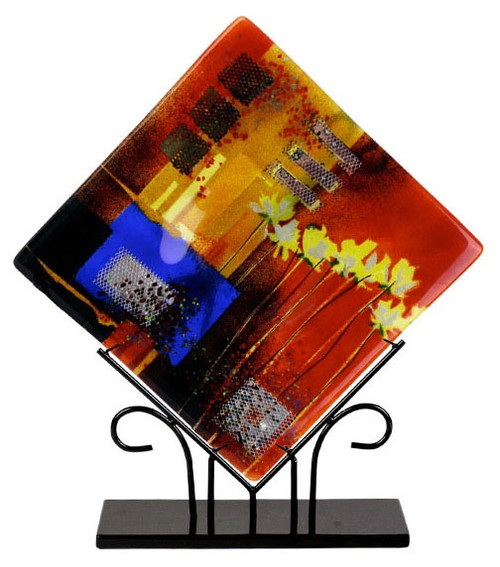 A beautiful multi colored fused art glass platter presented in a diamond shape