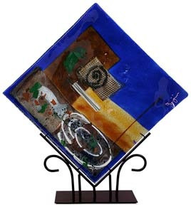 "15"" square fused glass platter featuring blue, yellow, red glass, with abstract designs and a white spiral"
