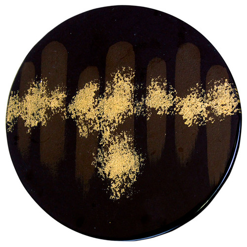 A fused glass cafe table featuring a black background with broad subtle brown vertical strokes, and hand-painted gold finishing touches