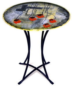 A contemporary fused glass cafe table featuring bright red poppies