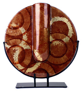 The Golden Ring round vase features red background of fused glass, with gold and black hand painted rings