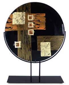 This large, decorative platter features an abstract design in black and gold with a broad orange stroke and some hand painting.