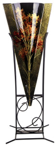 Fused glass triangular shaped floor vase stands 35 inches tall.  Brown with glasses and muted flowers.  Stand included