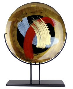 "20 inch round fused glass platter, standing 25"" tall, featuring gold and black, with hand painted blue, red and gold, broad brush strokes"