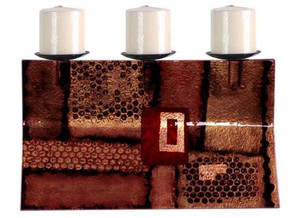 A triple candle holder in fused glass, featuring geometric shapes and perforated patterns.  Bronze, brown, gold