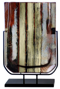 A 19 inch fused glass vase featuring red, black and white with three gold vertical stripes.  From the Gold Water series