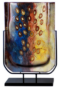 A 19 inch fused glass vase with blue and yellow theme, highlighted with red, and brown and gold hand painted details.  Stand included