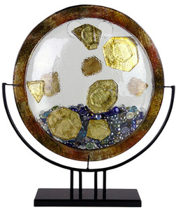 A round fused glass vase, with a bronze-like border, clear vessle and gold nugget appliques,  blue and green marbles, and stand included