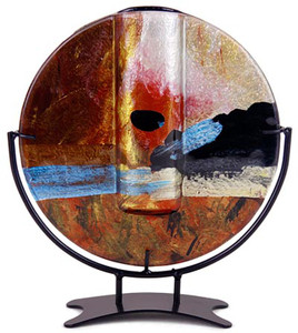 This round shape bud vase incorporates fused glass with red, blue, yellow gold and black.  In the Horizon series. Stand included
