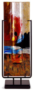 This tall rectangular bud vase incorporates fused glass with red, blue, yellow gold and black.  In the Horizon series. Stand included