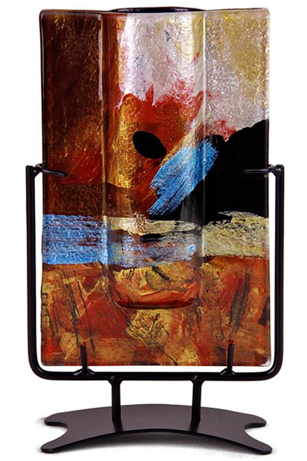 This 10 inch x 5 inch wide, rectangular bud vase incorporates fused glass with red, blue, yellow gold and black.  In the Horizon series. Stand included