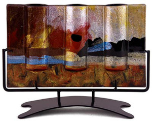 This 12 inch x 5 inch wide, rectangular triple bud vase incorporates fused glass with red, blue, yellow gold and black.  In the Horizon series. Stand included