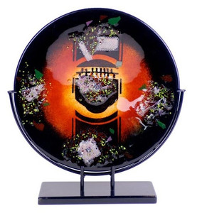 Round fused glass platter, featuring black, red and orange, with multiple collection of mesh screens and colors.  Stand included