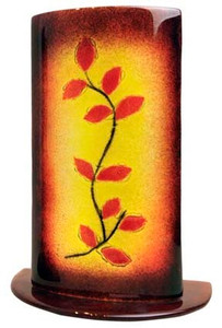 A 12-inch tall freestanding fused glass vase, featuring a yellow background, and red leaves on a vine