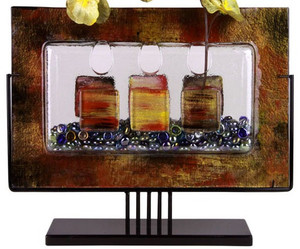 A wonderful 18inch fused glass art creation. A vase featuring side openings, in clear glass, with gold and red details. New concept series