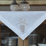 "Crown Linen White Table Topper with ""Pinecone"" Embroidery"