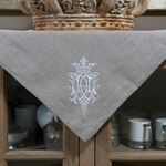 "Crown Linen Taupe Table Topper with ""Royal"" Embroidery"