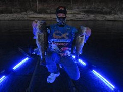 Bluewater LED Ultimate Deck Kit with angler kneeling on bow of boat.