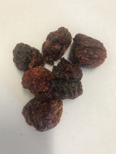 Extremely Hot! Comes in a glass jar.  The pods are nice to use for cooking.  You can grind it up in a coffee or spice grinder or just put the pod in the liquid.  Pierce a hole in it for more heat.  Do NOT eat whole or by itself.  Use it to add flavor and heat.