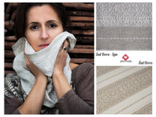This scarf is woven on white, as pictured on the bottom right-hand-side.