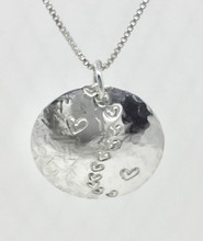 """Yin/yang is found in all creations in the universe. In many cultures the YIN/YANG speaks about interdependence of opposites that are actually complimentary to each other and interconnected.  We are the yin/yang with nature and each other in the world, coexisting, supporting and needing each other, even if we are complete opposites. The sterling silver pendant is textured with hammers and stamps to create the yin/yang design.  There are 3 sizes, Small measuring ½"""" diameter, Medium measuring 1"""" diameter and Large measuring 1-1/4"""" diameter.  See our chains and cords to compliment the pendant. CHAIN OR CORD NOT INCLUDED"""