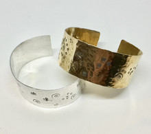 Cuffs Sterling $80. Brass $40. Approximately 1-1/2 inches wide. Hand stamped and hammered textured. Easily adjustable to fit all wrists