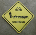 Dog sled crossing sign for outside.