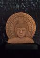 small sand stone Buddha