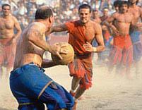 calcio storico combatants tussle over the ball