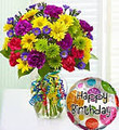 Fresh floral arrangement with vase and balloon