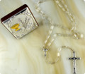Gift set includes a rosary with clear, glass beads and a standing plaque