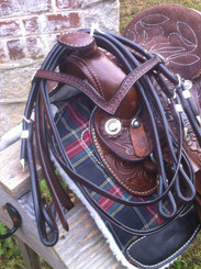 V-shaped Crest and handtooled design on rich dark brown burnished leather make this Western Bridle Headstall a great match to the Western Saddle.