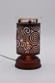 Touch oil lamp brown with circles.