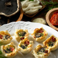 A beautiful puff pastry flower filled with portabella mushrooms, a blend of lightly seasoned ricotta and mozzarella cheese, topped with a sun dried tomato.   Units/case: 100