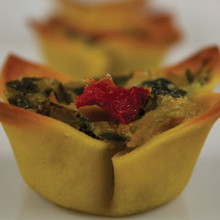 A unique blend of crisp baby spinach, artichoke, and aged Parmesan cheese layered into a flower shaped tart shell.   Units/case: 100