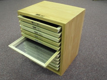 Optional Cabinet holds sieves for easy use.