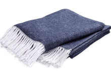 Made in Portugal from soft brushed cotton with a fun fringe trim, it works in both modern and traditional spaces.
