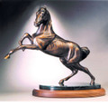 "Connie Foss Lost Wax Bronze ""Style""  SKU # A21-2509C  ""Style"" Lost Wax Bronze Sculpture on Marble & Hardwood Base by renowned sculptor Connie Foss.  35 lbs.  19""H x 21""W  Please allow 3 months for casting."
