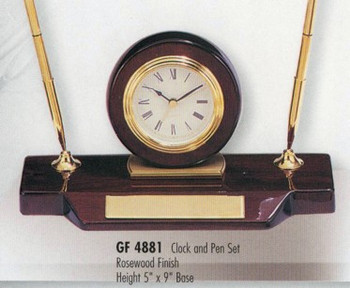 """Clock and pen set rosewood piano finish, 5"""" tall x 9"""" wide, with 2 quality pens."""
