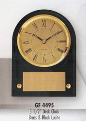 "Clock desk black and brass acrylic, 5-1/2"" tall."